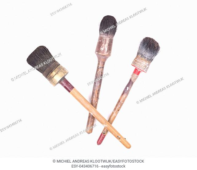 Old and used paint brushes, on white background