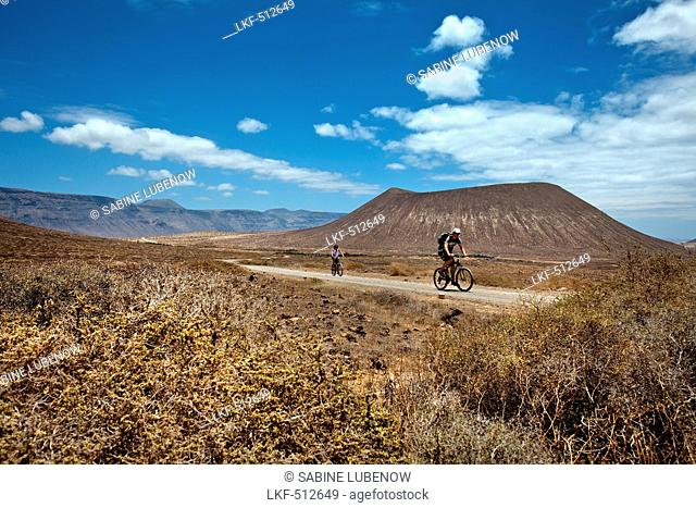 Cyclist on the island of La Graciosa, Lanzarote, Canary Islands, Spain