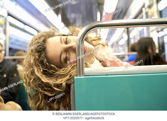 dizzy woman in public transport metro train, in Paris, France
