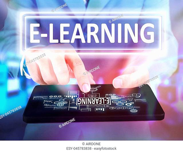Business Education Concept. Businessman click e-learning button on his tablet. e Learning Text typography design
