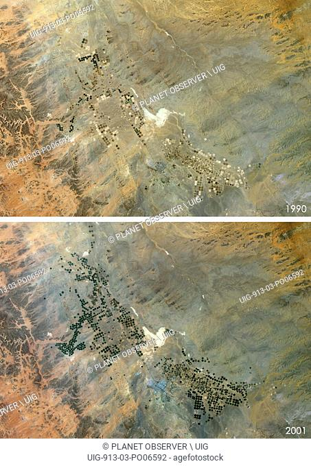 Satellite view of Agriculture in the Desert in Tabuk Region, Saudi Arabia in 1990 and 2001. This before and after image shows the expansion of circular...