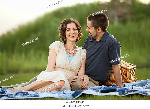 Caucasian couple enjoying picnic