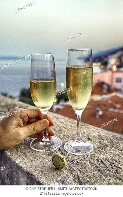 Champagne filled glasses on a hotel balcony