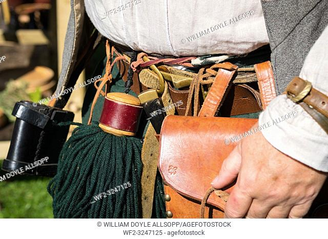 A member of the Sealed Knot wearing typical items for an archer of the period including the tassel used to clean arrows