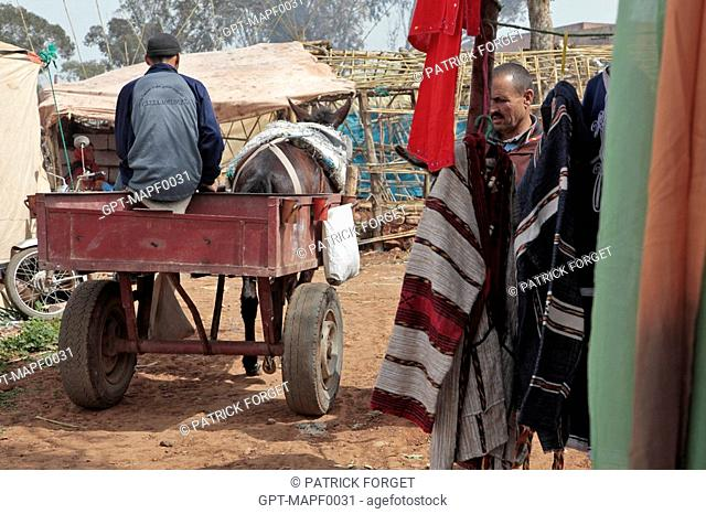 HORSE-DRAWN CART IN THE BERBER MARKET OF TAHANAOUTE, AL HAOUZ, MOROCCO