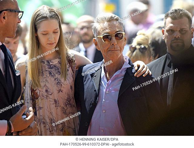 """Model Ivana Teklic (L) and fashion designer Wolfgang Joop attend the presentation of his collection """"""""Looks"""""""" for the textile chain Breuninger in Duesseldorf"""