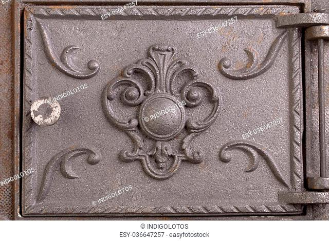 Cast iron door for furnaces. Fragment close up
