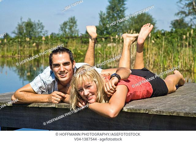 Young couple relaxing at a lake, Germany, Europe