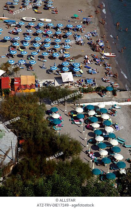 BLUE, GREEN, WHITE & YELLOW PARASOLS ON BEACH; MARINA DI VIETRI, ITALY; 18/09/2011