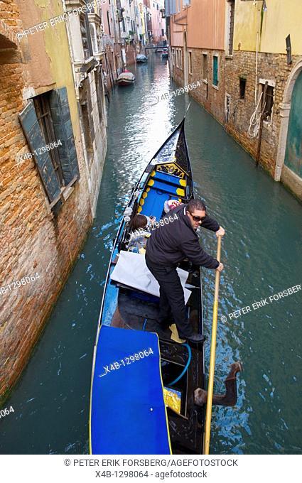 Gondolier central Venice the Veneto northern Italy Europe