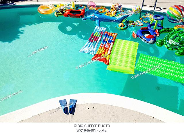 Swimming pool full of inflatable toys