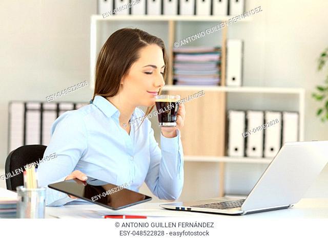 Office worker relaxing having a break smelling coffee