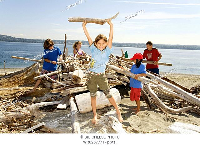 Group of children building beach fort