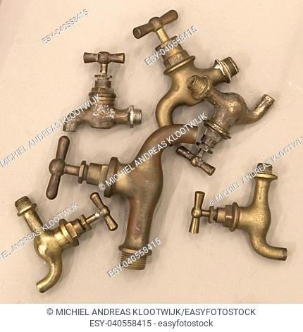 Collage of vintage water faucets on solid background