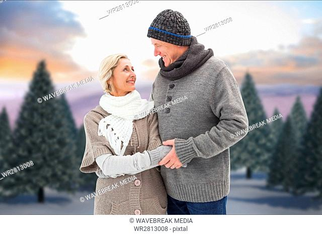 Romantic senior couple wearing sweaters during winter