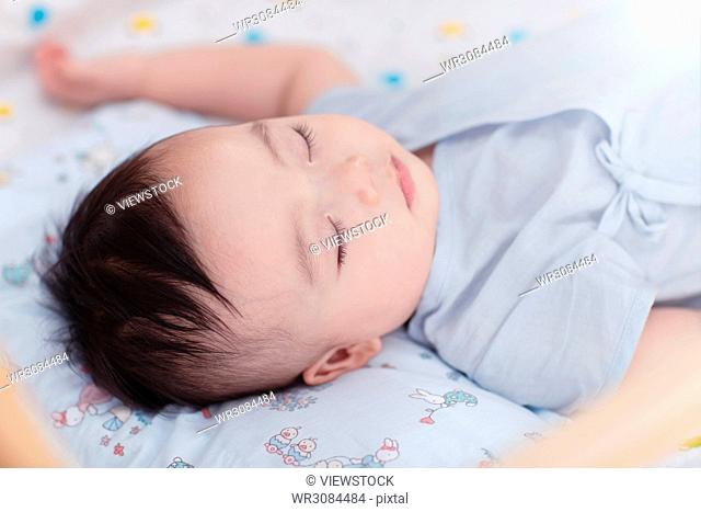 The male baby is sleeping