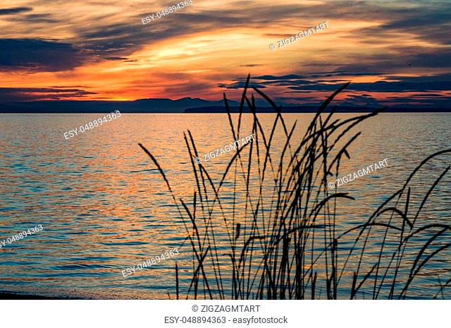 Sunset on Semiahmoo Bay produces a peaceful image of water and clouds