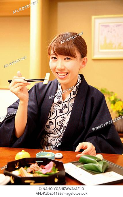 Young Japanese woman wearing yukata at traditional ryokan inn