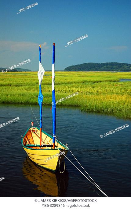 A small dinghy floats on the Essex River in Massachusetts
