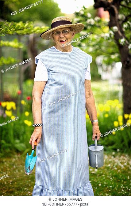 Senior woman in her garden, Sweden
