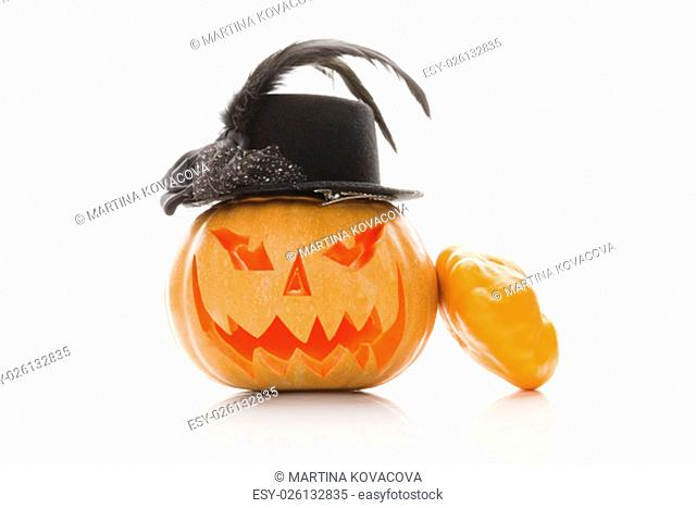 Creepy halloween pumpkin with hat isolated on white background. Traditional american halloween decoration