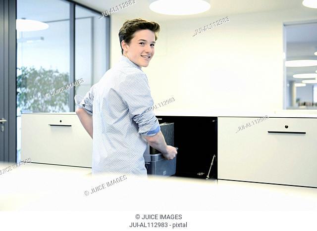 Teenage boy in office, portrait