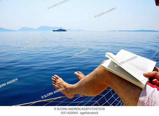 Reading aboard a yacht i Greece