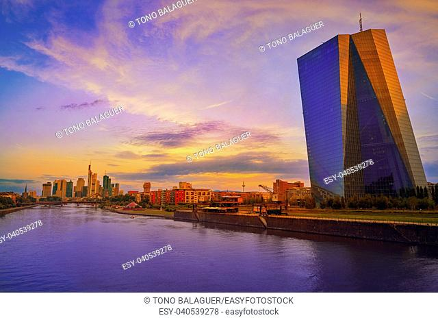 Frankfurt skyline at sunset in Germany with Meno river and Hafenkran building