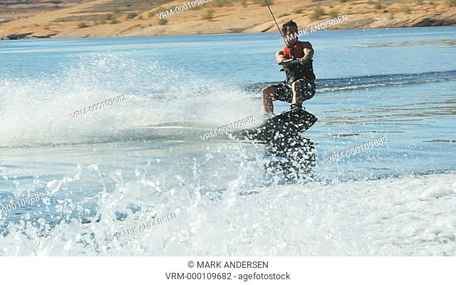 man wakeboarding