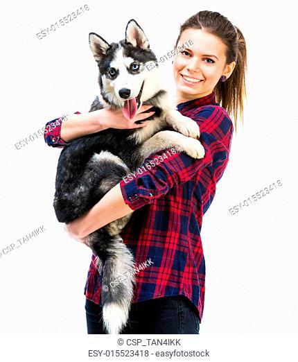 women with her puppy Husky