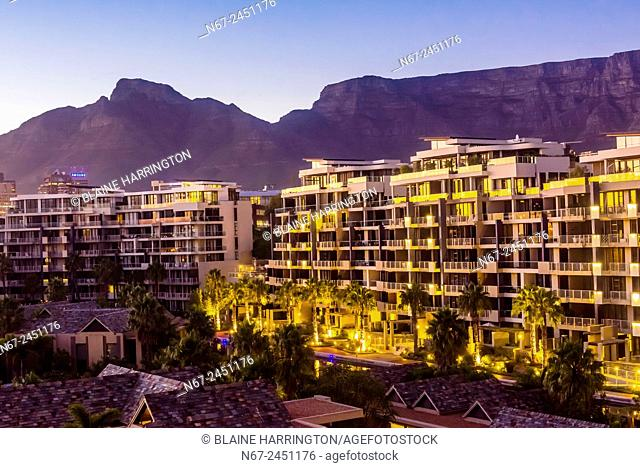 View from balcony at sunrise with apartment buildings and Table Mountain in background, Hotel One&Only Cape Town, V&A Waterfront, Cape Town, South Africa
