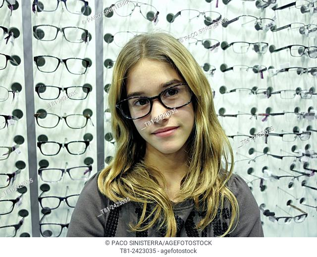 girl with glasses in a shop in Paris, France