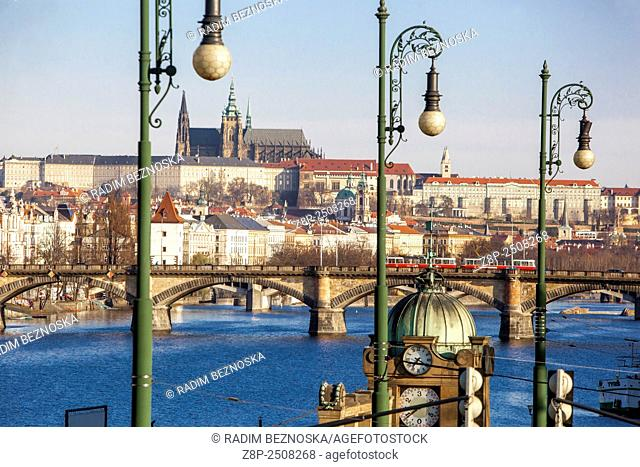 Panorama of Prague with Vltava river, In the foreground, the Art Nouveau style lamps