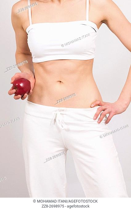 Close up of a healthy woman holding a red apple