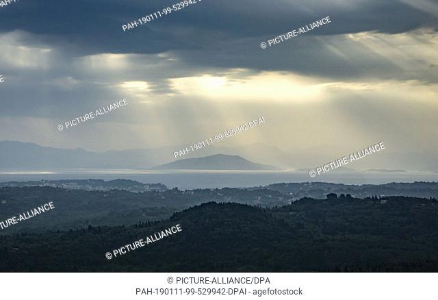 03 May 2018, Greece, Korfu: View over the landscape, the Ionian Sea and the Greek mainland behind from the island Corfu (below)