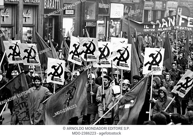 Many demonstrators, members of the association Sinistra Proletaria, attending a parade. Milan, 1969