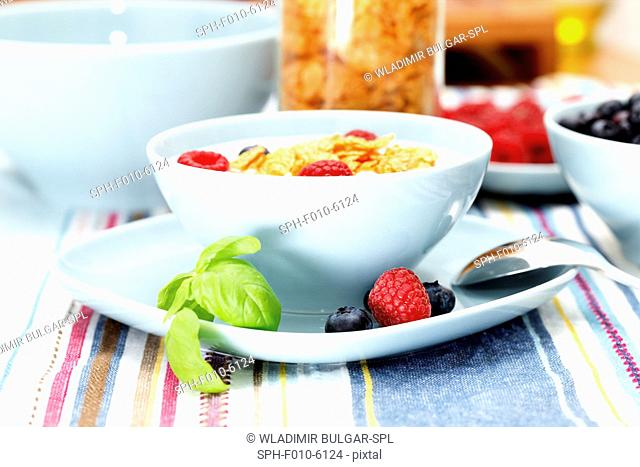 Bowl of cereal and fruits for breakfast