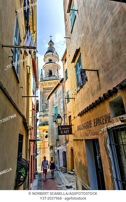 Europe, France, Alpes-Maritimes, Menton. Couple of tourists walking in the old town