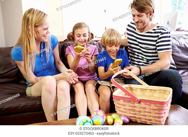 Family With Easter Eggs At Home