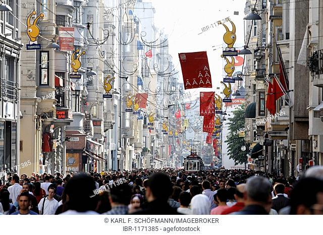Historic tram driving through the crowd, shopping street Istiklal Caddesi, Independence Street, Beyoglu, Istanbul, Turkey