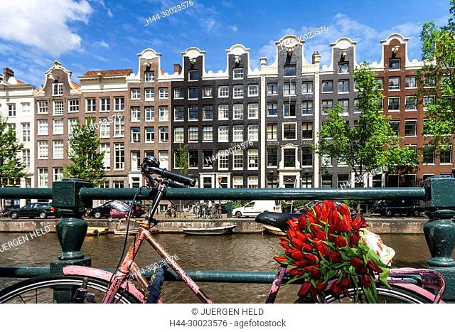 Amsterdam, street cafe at a canal typical architecture