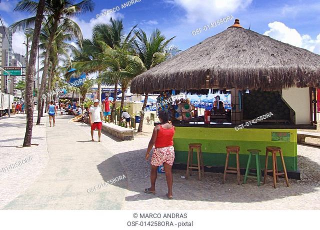 people walking at pernambuco beach sidewalk