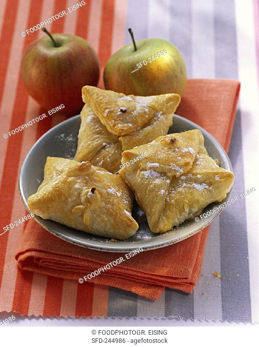 Apple and cinnamon pasties with icing sugar