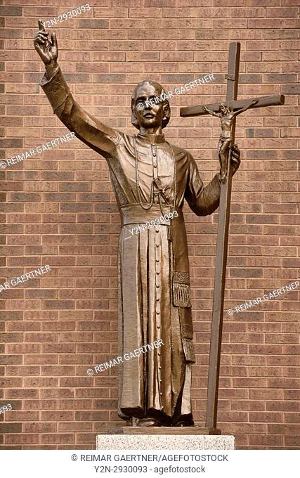 Statue of Gaspar del Bufalo a Roman Catholic priest and founder of the Missionaries of the Precious Blood outside St Roch's church Toronto Canada