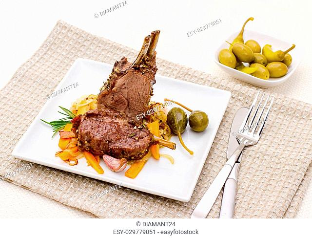 Grilled rack of lamb with carrot onion, garlic and rosemary