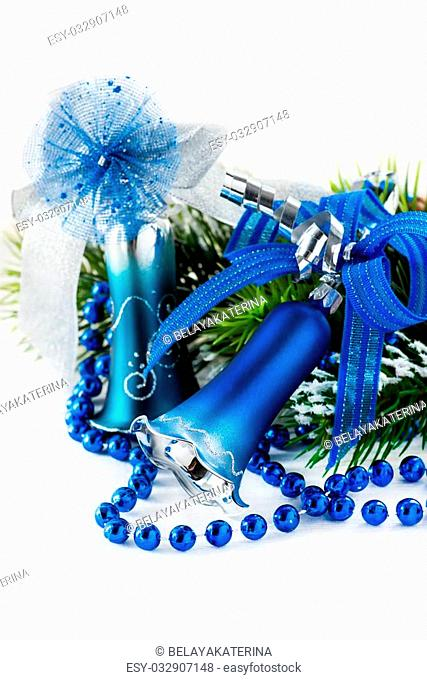 Blue Christmas decoration bells on light background, selective focus