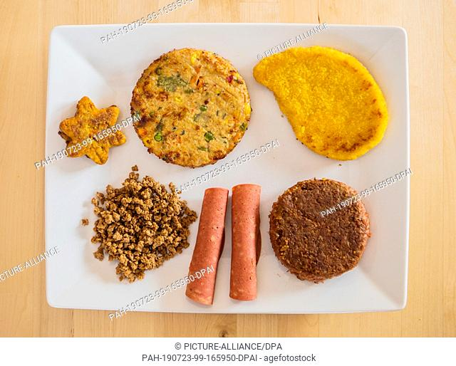 22 July 2019, Hessen, Frankfurt/Main: Various vegan and vegetarian meat substitutes lie on one plate. More and more meat replacement products are coming onto...