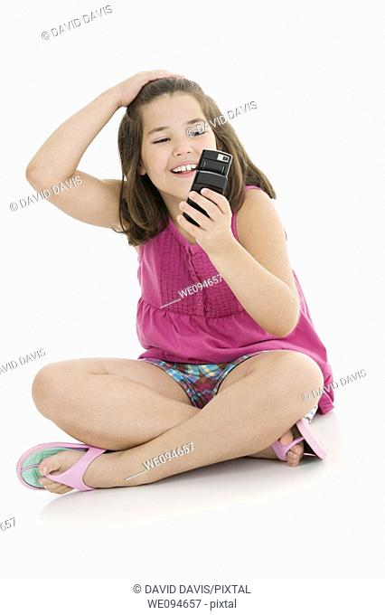 Cute Caucasian girls texting on a cell phone