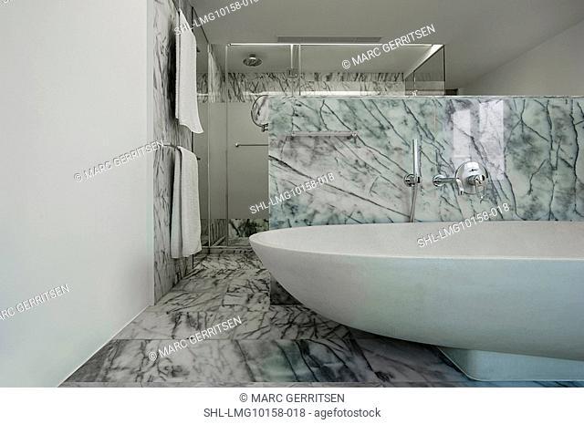 Large bathtub in marble bathroom