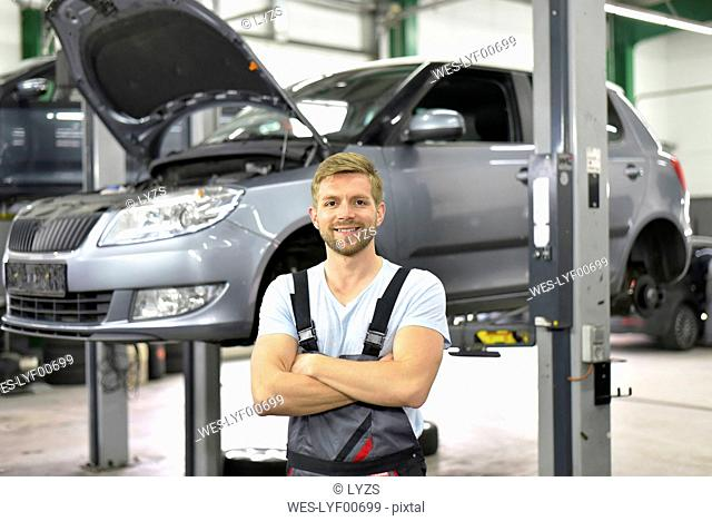 Portrait of smiling car mechanic in a workshop
